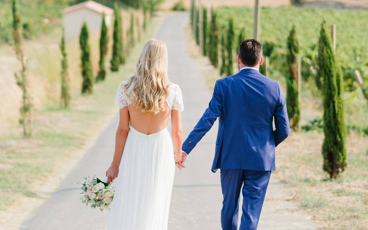 bride and groom holding hands, herault room rental, château les carrasses